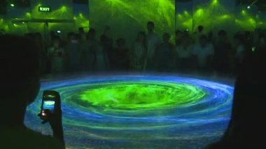 People look at impressive laser light 3D visualization