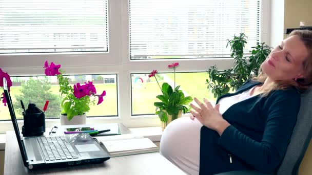 Tired pregnant woman yawn lying in chair near computer