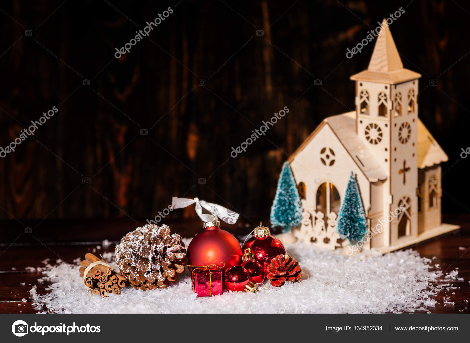 Stylish Rustic Winter Wallpaper With Pine Cones Baubles And Wooden Church Stock Photo