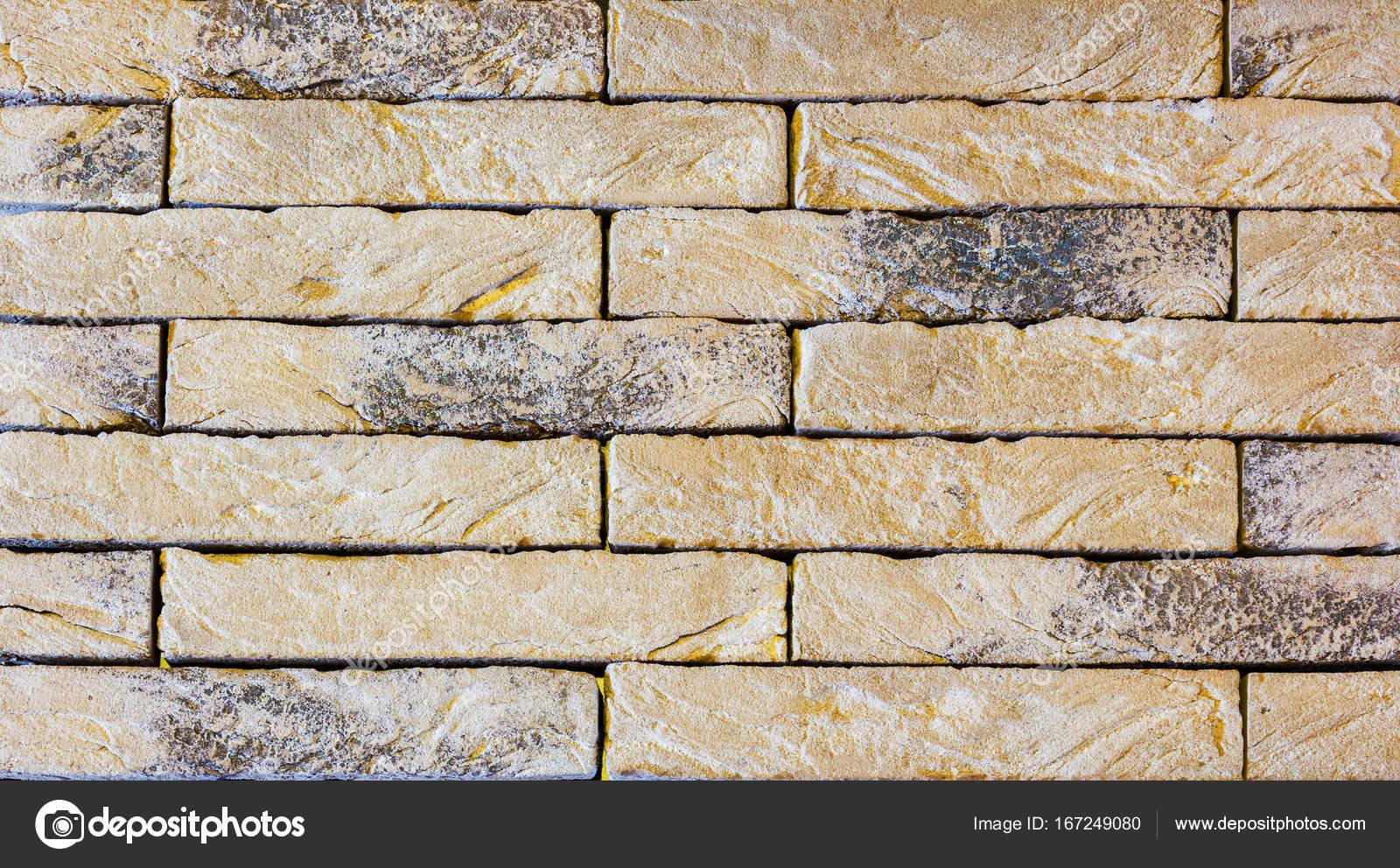 La texture delle piastrelle della facciata materiale del