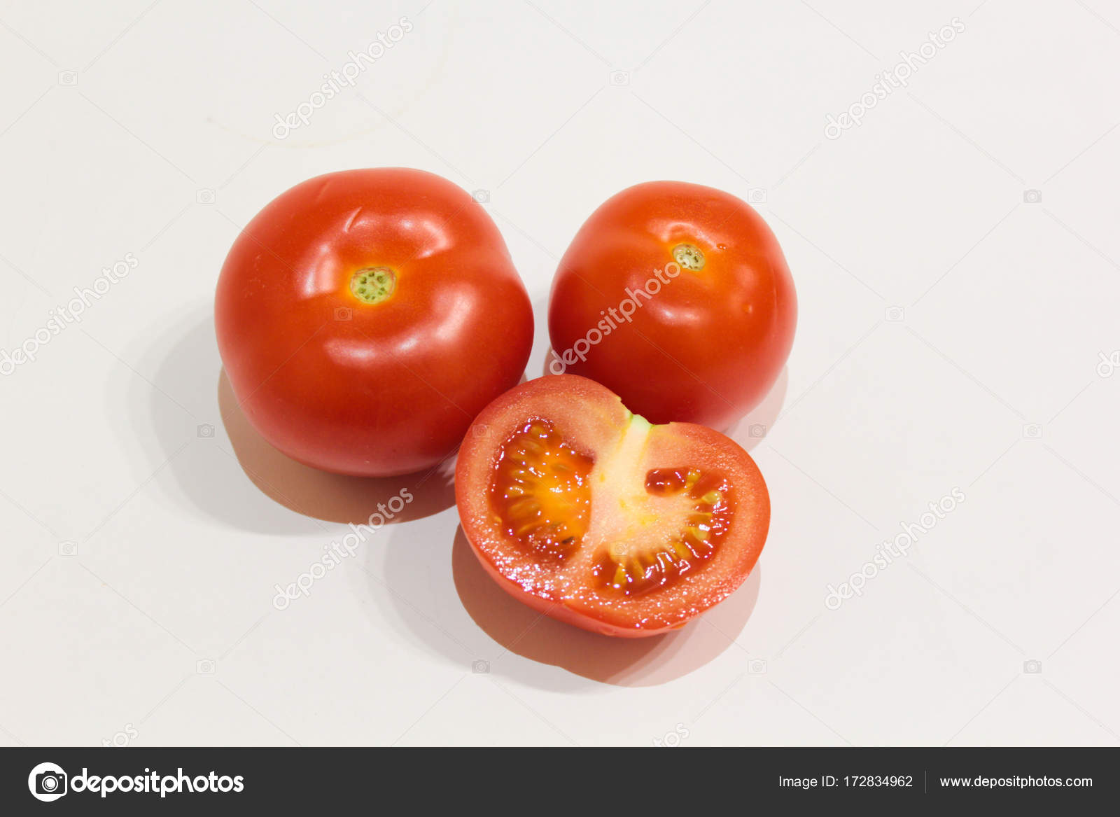 red tomatoes white background sliced tomatoes stock photo