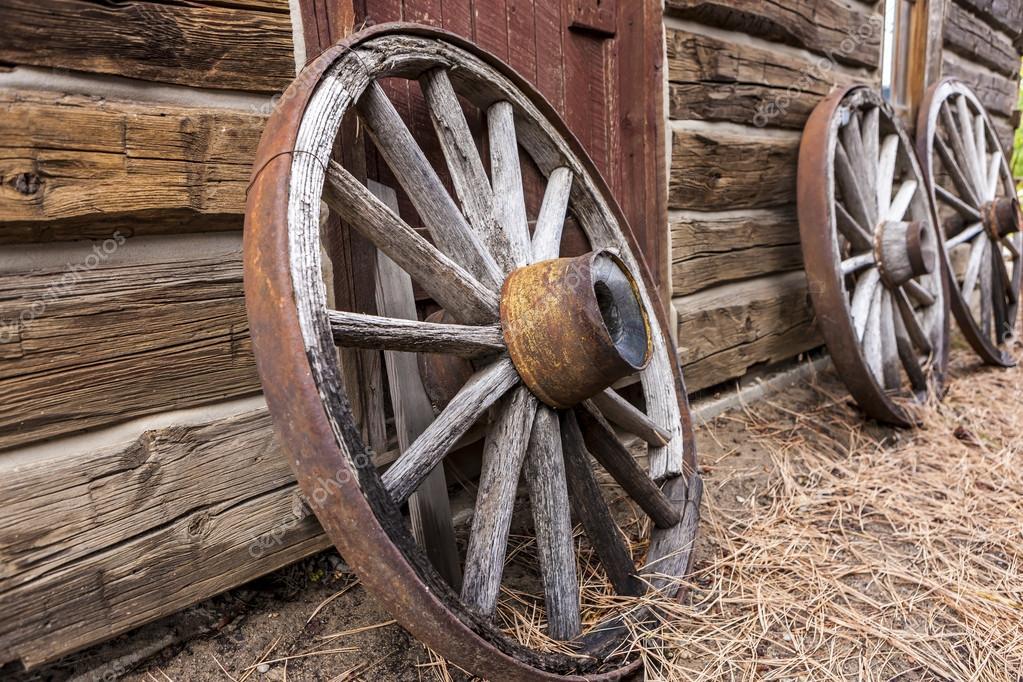 Old Wagon Wheels Against A Wall. U2014 Stock Photo