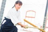 Fotografie Woman having Aikido sword fight