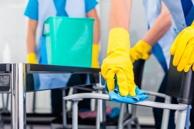 Cleaning ladies working as team in office