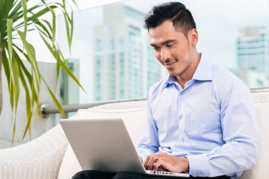 Businessman working with laptop from home