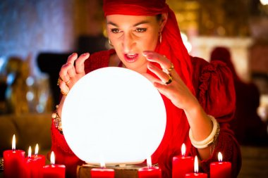 Fortuneteller at Seance or session with Crystal ball