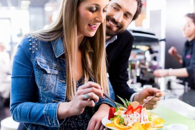 Woman eating fruit sundae