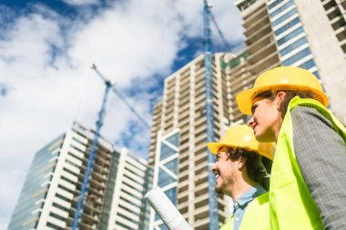 Architects supervising progress of high rise project