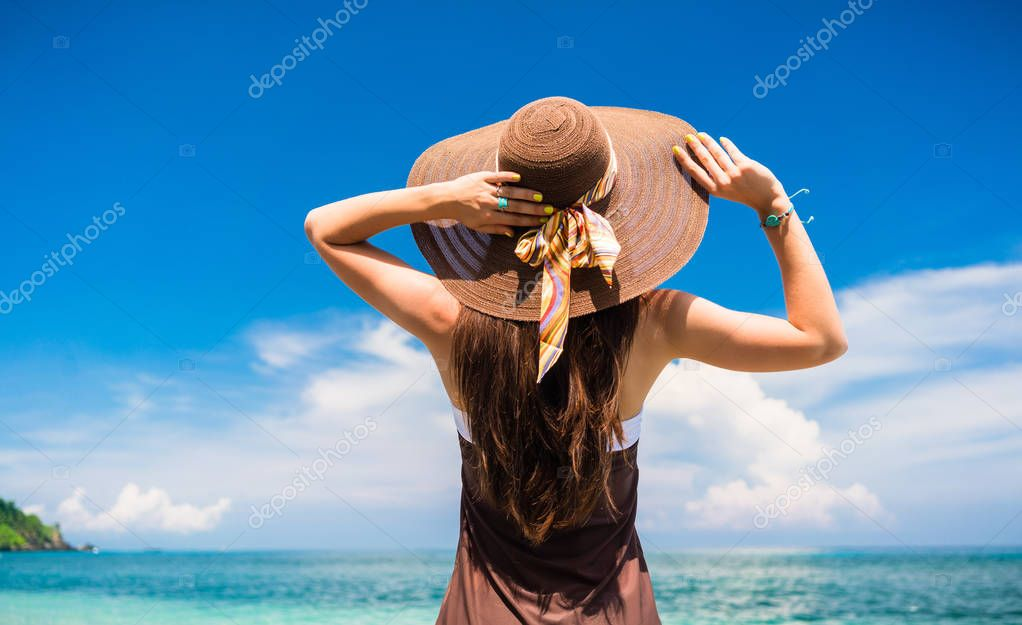 Woman enjoying the view at the beach or ocean