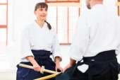 Fotografie Man and woman having Aikido sword fight