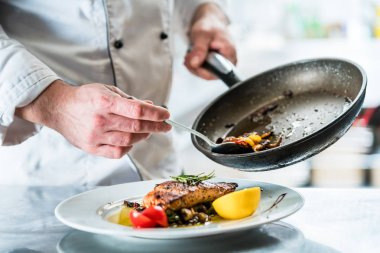 Chef finishing food