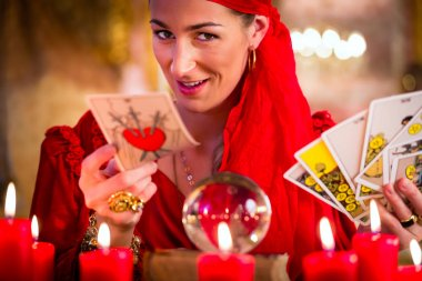 Soothsayer in Seance or session with tarot cards