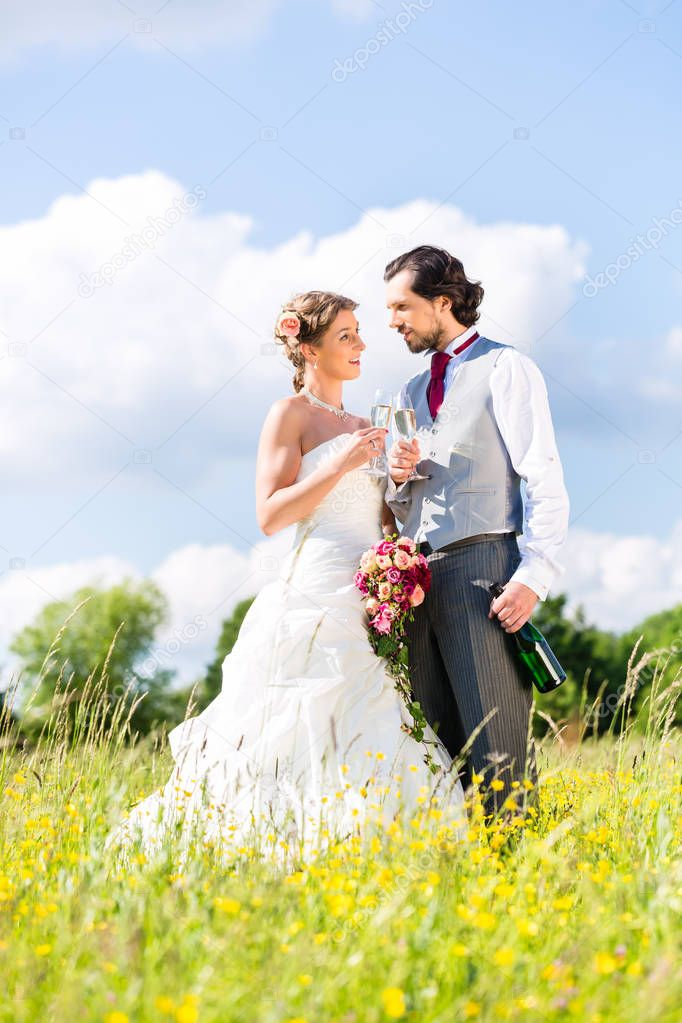 Bridal pair celebrate wedding day with champagne