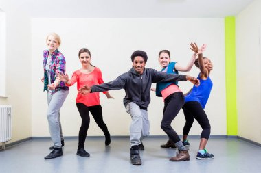 Young man and women in dance class