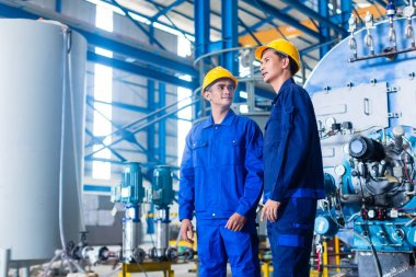 Worker in Asian manufacturing plant