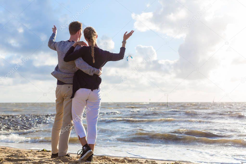 Couple in romantic sunset on ocean beach