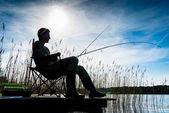 Halász, vagy a horgász-tó Sunrise háttérvilágítással