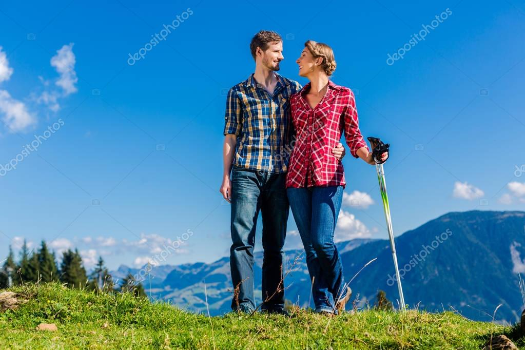 Couple enjoying view in the mountains