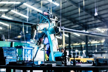 Welding robot in production plant