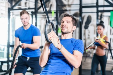 Man at rings doing fitness exercise