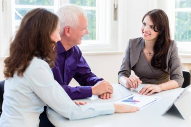 Senior woman and man at retirement financial planning