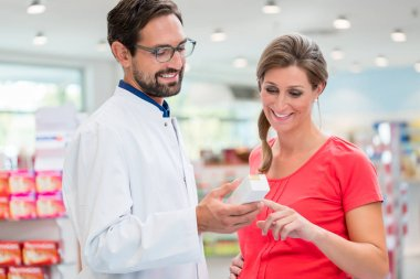 Pregnant woman shopping in drug store