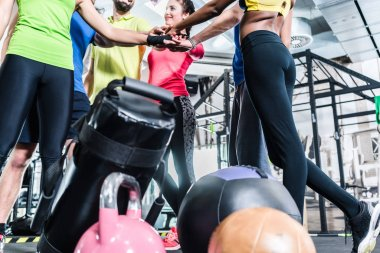 Woman and men being motivated for fitness and sport