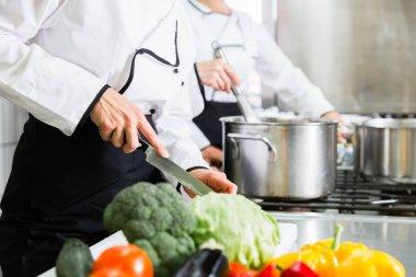 Chefs preparing meals