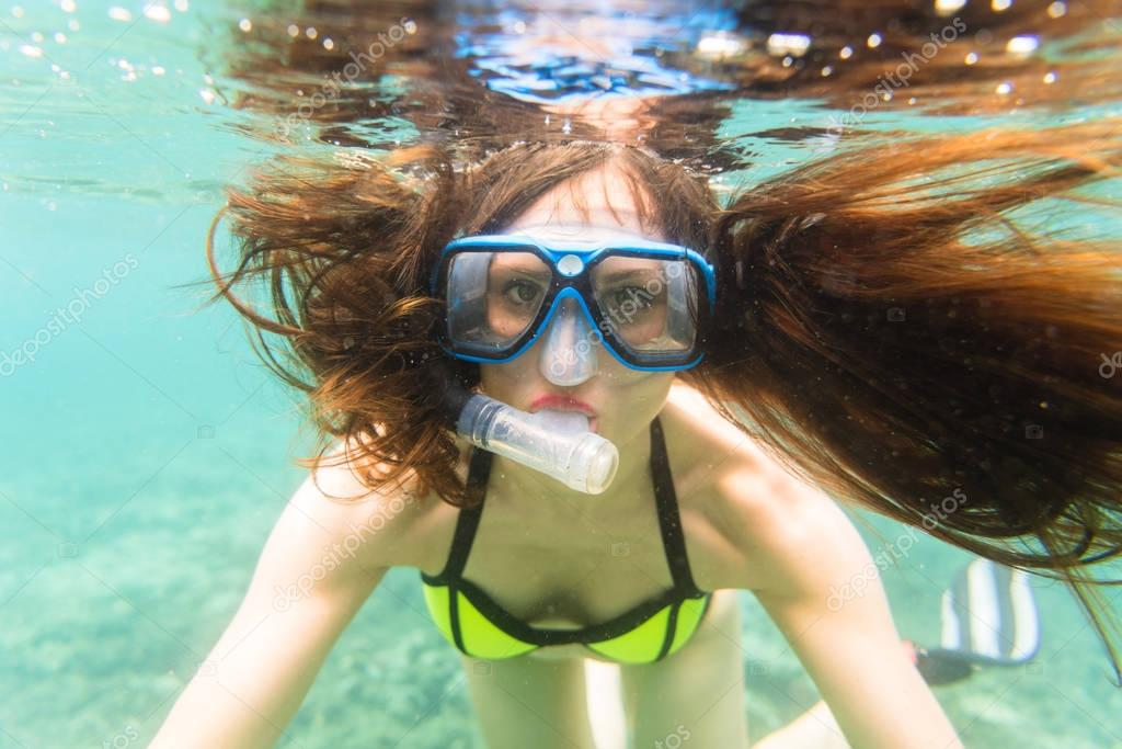 Woman in summer vacation snorkeling in ocean