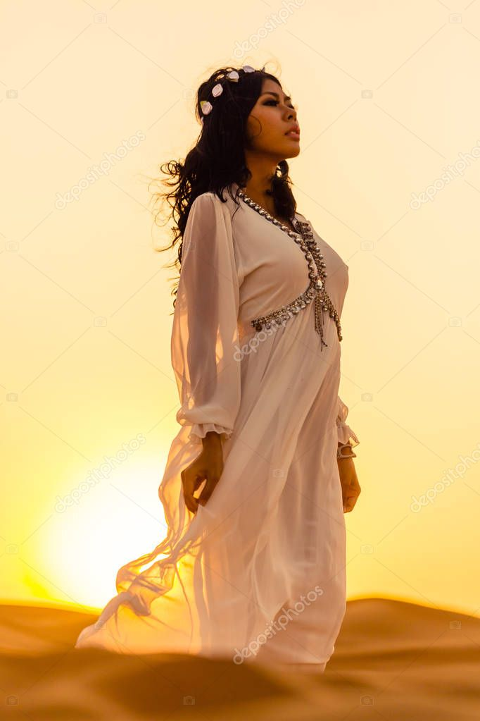 Beautiful woman in desert