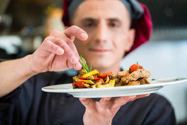 Chef showing proud food or dish he cooked