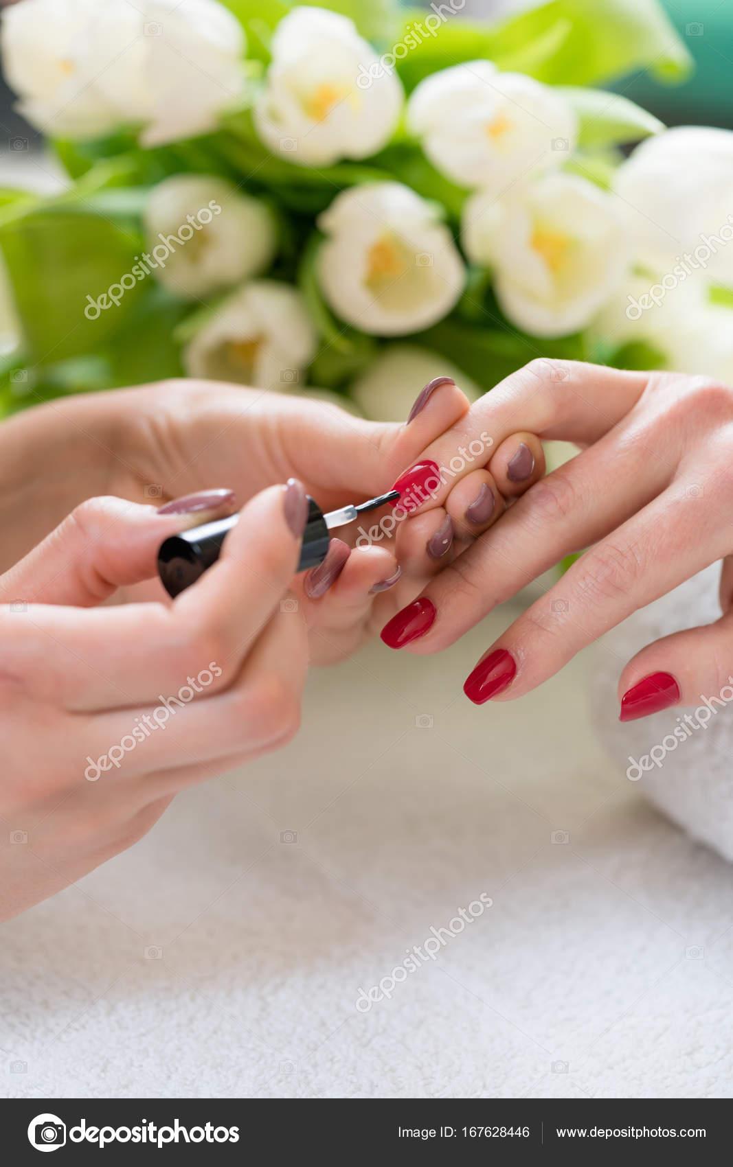manicurist applying elegant nail polish — Stock Photo © Kzenon ...