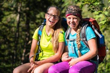 Friends or sisters hiking in woods
