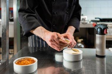 Chef or patissier preparing dessert