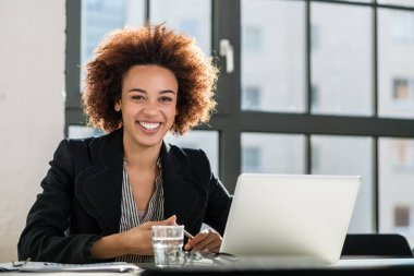 Woman working on laptop in the office