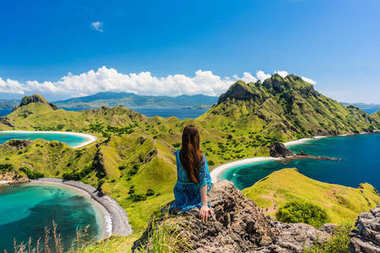 Young woman enjoying the awesome view of Padar Island during sum
