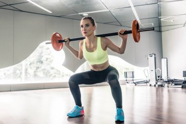 young woman holding barbell