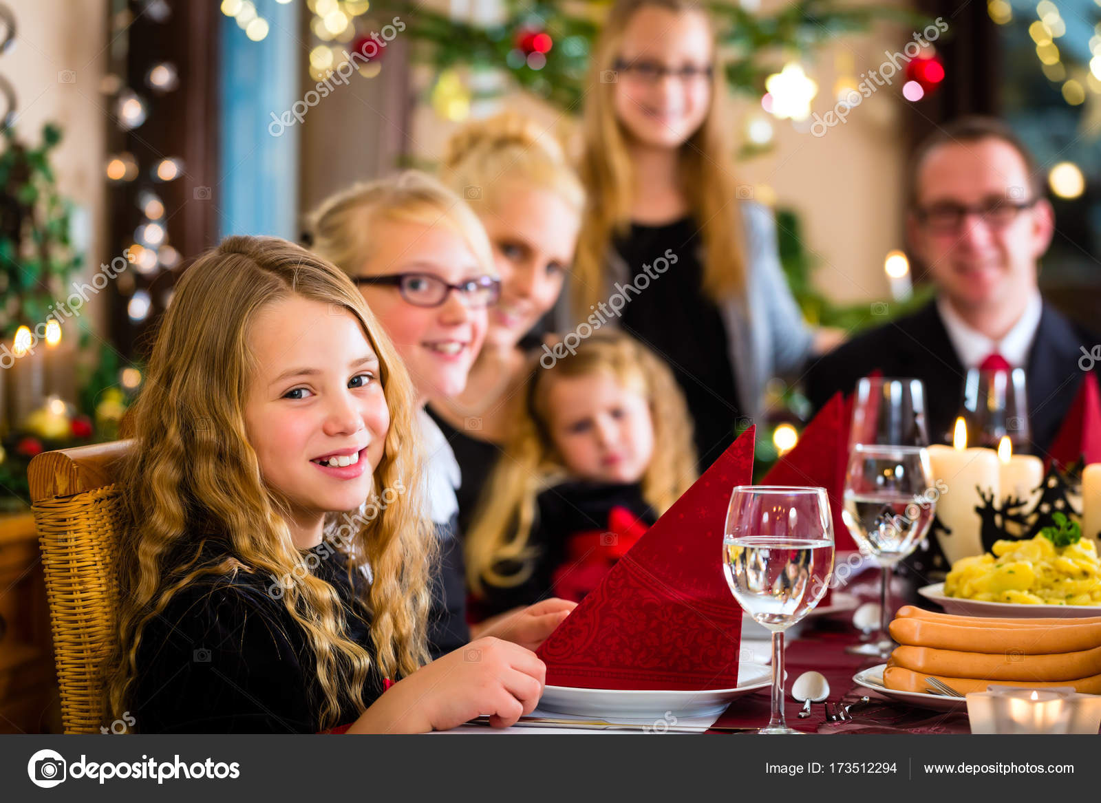 family having german christmas dinner stock photo