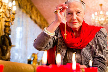 Fortuneteller in Seance with pendulum
