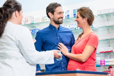 Woman and man in pharmacy shopping