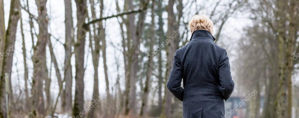 Unhappy woman having walk