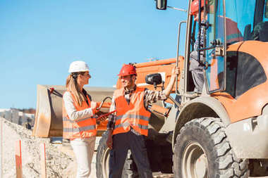 Civil engineer and worker on construction site