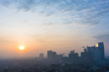 Panoramic view of Jakarta cityscape at sunrise