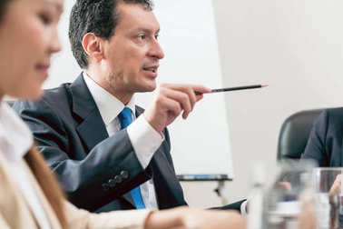 Expert businessman sharing his view during a decision-making meeting