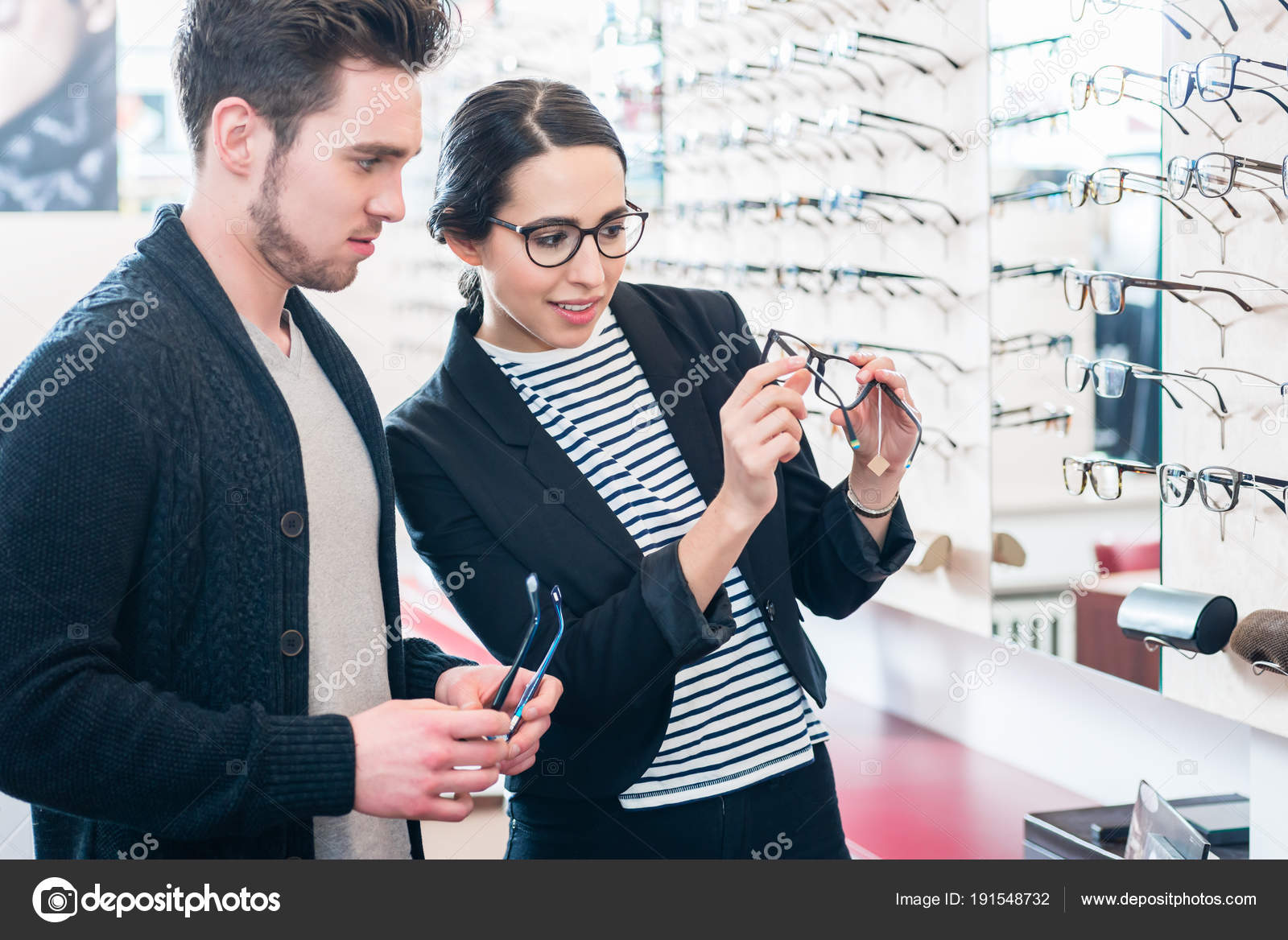 bafe3542e6 Woman and man buying glasses in optician shop — Stock Photo © Kzenon ...