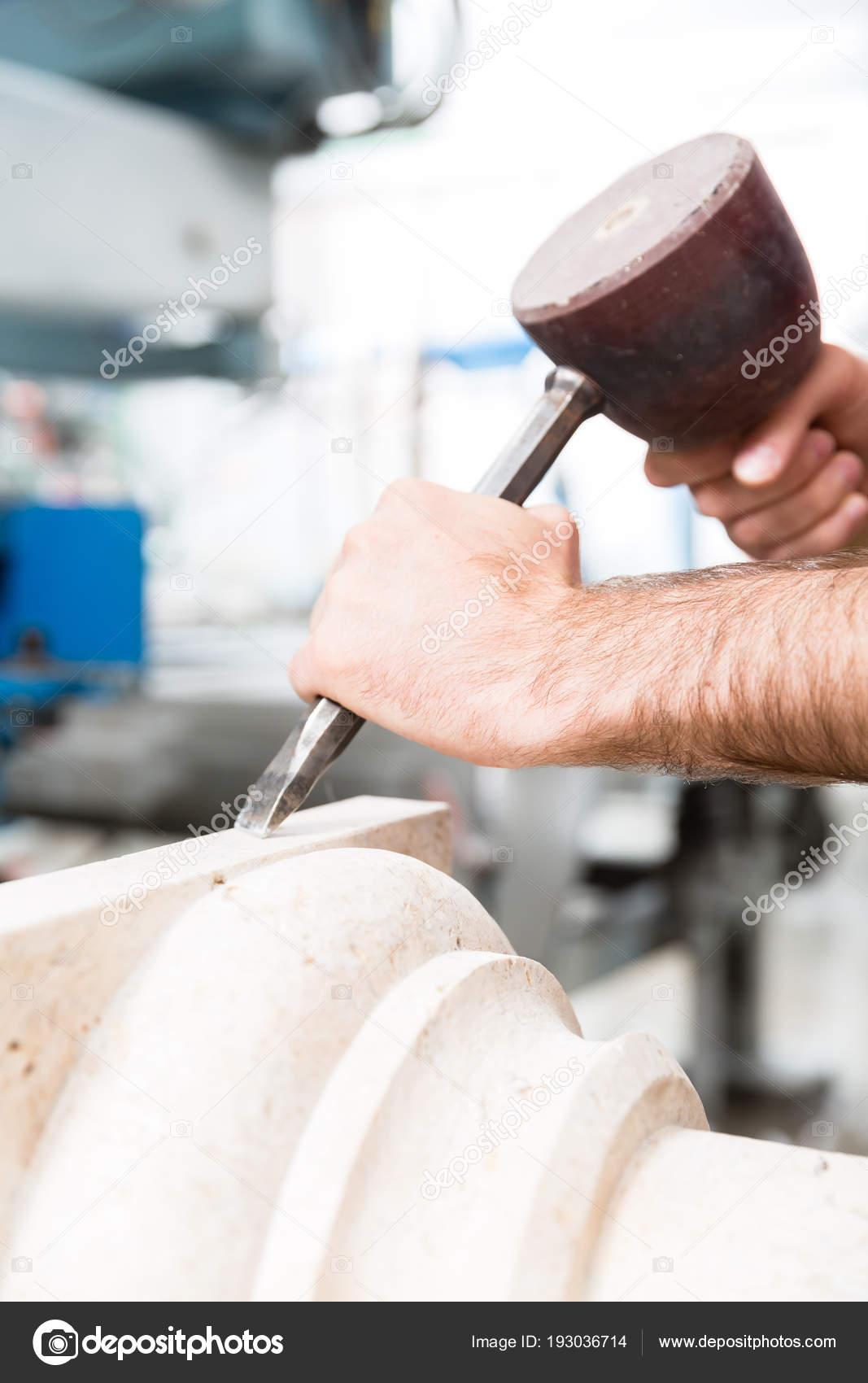 Stonemason working at marble pillar — Stock Photo © Kzenon