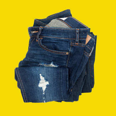 Casual jeans on yellow background