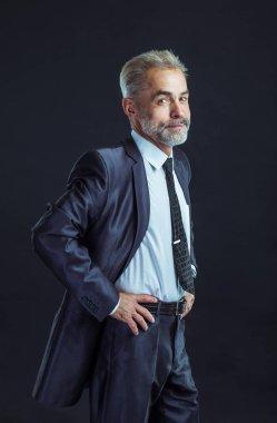 portrait of confident businessman in a business suit on a black background
