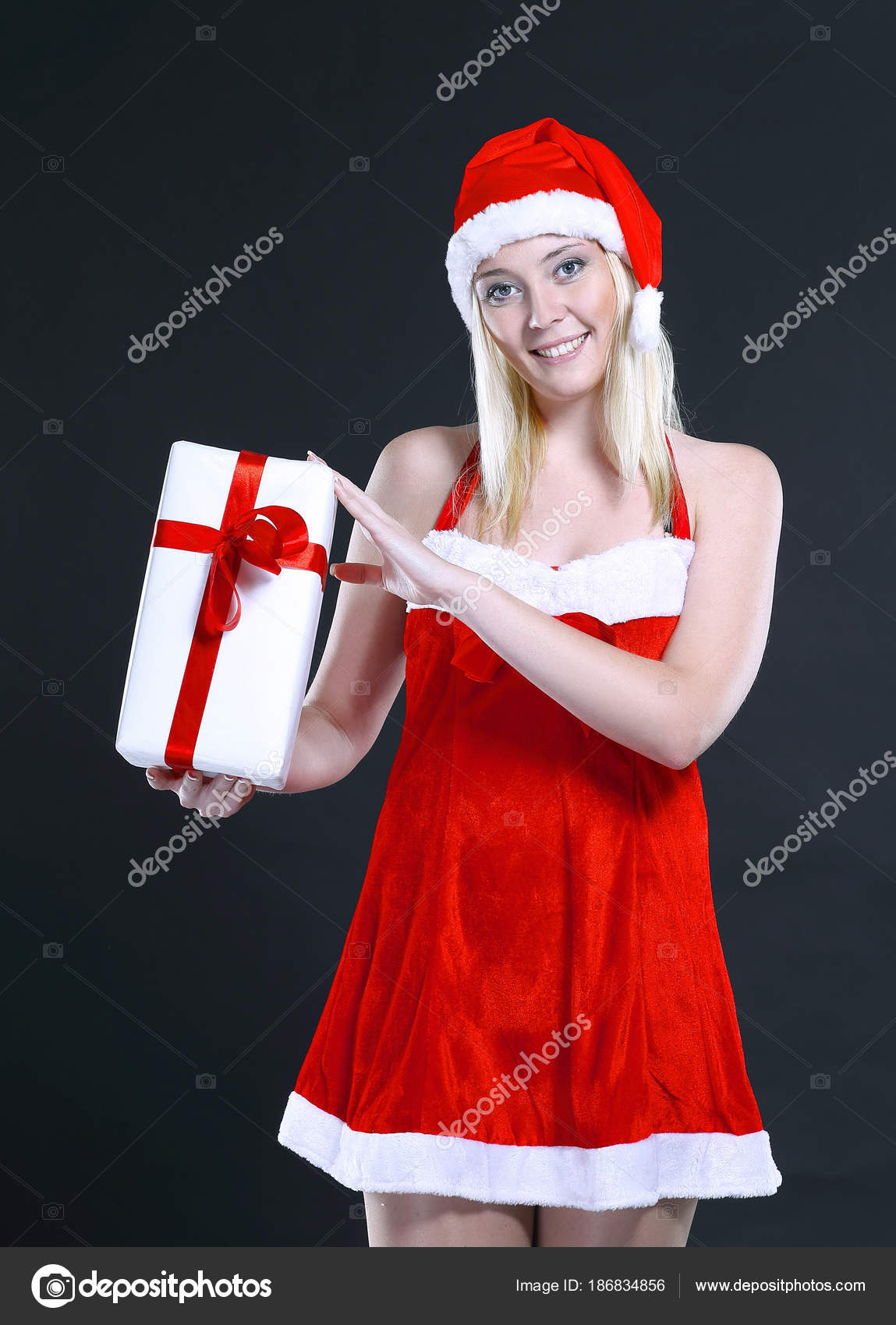blonde woman in costume of Santa Claus with Christmas gift. — Stock ...