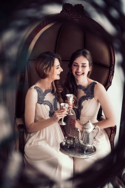 close up. happy bridesmaids with champagne glasses